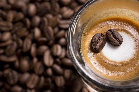 capacino: A cup of expresso macchiato with some roasted beans