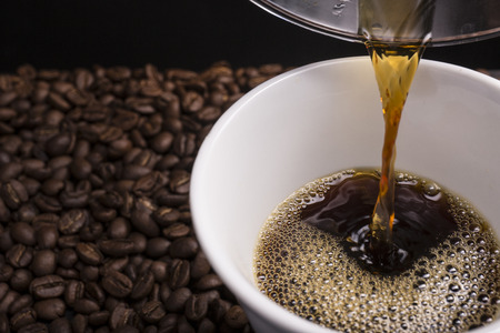 coffee machines: Hand drip coffee being poured into the cup