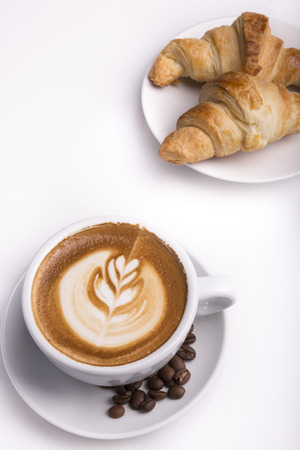 capucinno: Croissant with a cup of latte