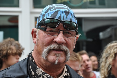 Breda, Netherlands, August 15, 2010, Harleyday,  Rider with cap and glasses on his forehead at Harleyday in Breda (2010)