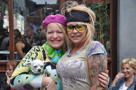 Breda, Netherlands, August 15, 2010, Harleyday, Two striking women fron the audience posing with a little white dog at Harleyday in Breda (2010)