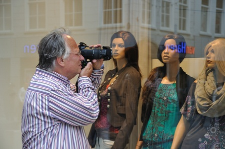 Breda, Netherlands, August 15, 2010, Harleyday,  Man photographing window mannequins at Harleyday in Breda (2010) Stock Photo - 8722643