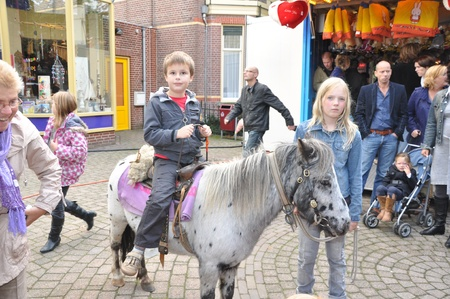 made in netherlands: Made, Noord-Brabant, Netherlands - September 26, 2010 - Colorful fair in a small Dutch village, donkey riding Editorial