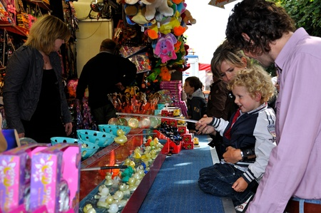 made in netherlands: Made, Noord-Brabant, Netherlands - September 26, 2010 - Colorful fair in a small Dutch village, a little blonde boy fishes for a duck out of the box Editorial