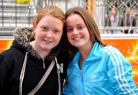noord: Made, Noord-Brabant, Netherlands - September 26, 2010 - Colorful fair in a small Dutch village, two smiling young girls posing for the photographer