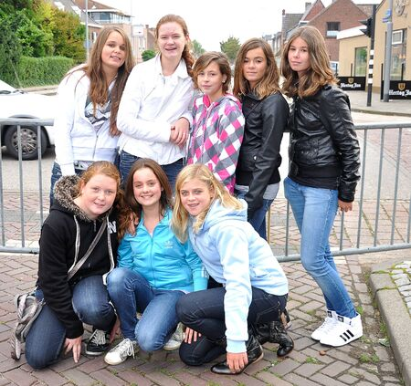 made in netherlands: Made, Noord-Brabant, Netherlands - September 26, 2010 - Colorful fair in a small Dutch village, eight young girls posing for the photographer Editorial