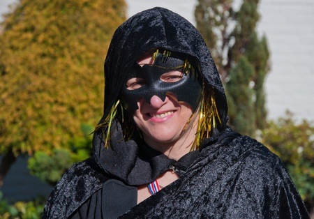 drimmelen: Made, North-Brabant, Netherlands – March 6, 2011 - Dutch carnival in the streets of a small village,  black costumed woman