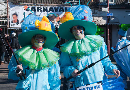 drimmelen: Made, North-Brabant, Netherlands – March 6, 2011 - Dutch carnival in the streets of a small village, two costumed fishing women