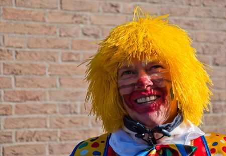 drimmelen: Made, North-Brabant, Netherlands – March 6, 2011 - Dutch carnival in the streets of a small village, portrait of clown