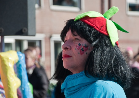 drimmelen: Made, North-Brabant, Netherlands – March 6, 2011 - Dutch carnival in the streets of a small village, portrait of a woman with a hat  Editorial