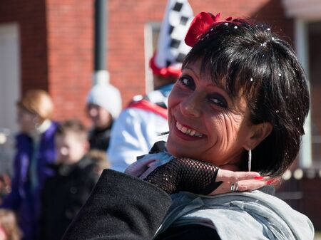 drimmelen: Made, North-Brabant, Netherlands – March 6, 2011 - Dutch carnival in the streets of a small village,  portrait of a pretty woman