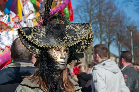 drimmelen: Made, North-Brabant, Netherlands – March 6, 2011 - Dutch carnival in the streets of a small village, man with a large hat