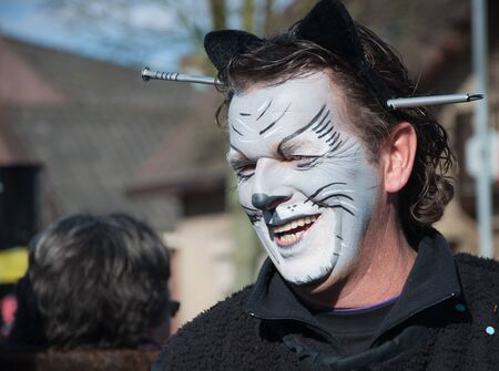 made in netherlands: Made, North-Brabant, Netherlands – March 6, 2011 - Dutch carnival in the streets of a small village, man with a large nail trhough his head Editorial