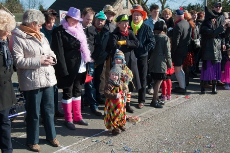 drimmelen: Made, North-Brabant, Netherlands – March 6, 2011 - Dutch carnival in the streets of a small village, divers audience Editorial