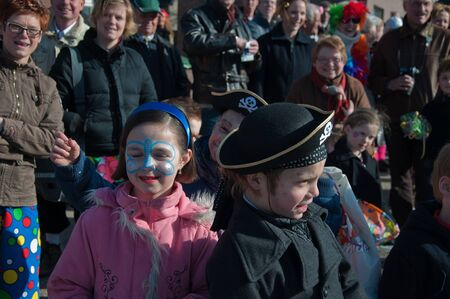 drimmelen: Made, North-Brabant, Netherlands – March 6, 2011 - Dutch carnival in the streets of a small village, costumed children Editorial