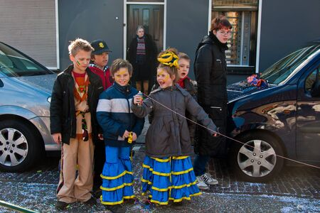 drimmelen: Made, North-Brabant, Netherlands – March 6, 2011 - Dutch carnival in the streets of a small village, costumed  kids Editorial