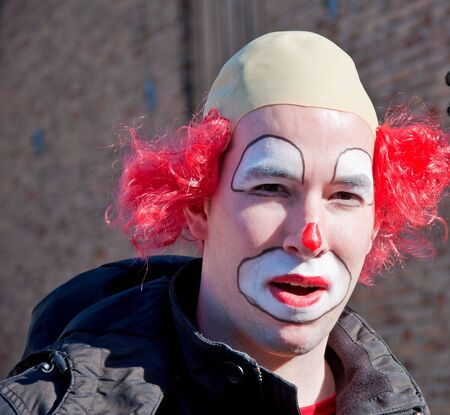 drimmelen: Made, North-Brabant, Netherlands – March 6, 2011 - Dutch carnival in the streets of a small village, portrait of a colorful clown