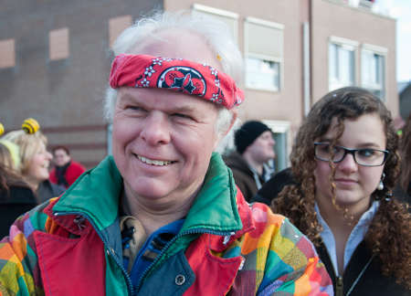 drimmelen: Made, North-Brabant, Netherlands – March 6, 2011 - Dutch carnival in the streets of a small village, costumed man smiling