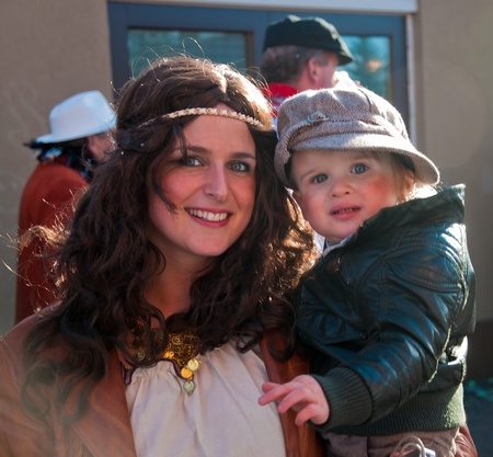 drimmelen: Made, North-Brabant, Netherlands – March 6, 2011 - Dutch carnival on the streets of a small village, mother with child