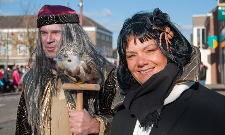 drimmelen: Made, North-Brabant, Netherlands – March 6, 2011 - Dutch carnival on the streets of a small village, costumed man and woman