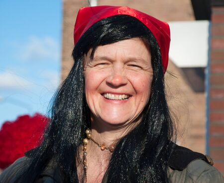 drimmelen: Made, North-Brabant, Netherlands – March 6, 2011 - Dutch carnival on the streets of a small village, woman with black hair