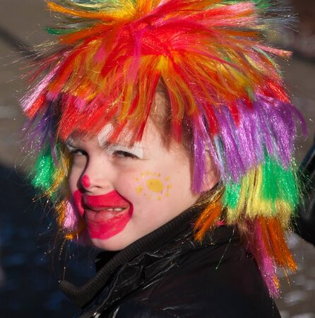 drimmelen: Made, North-Brabant, Netherlands – March 6, 2011 - Dutch carnival on the streets of a small village,  child with colored wig Editorial