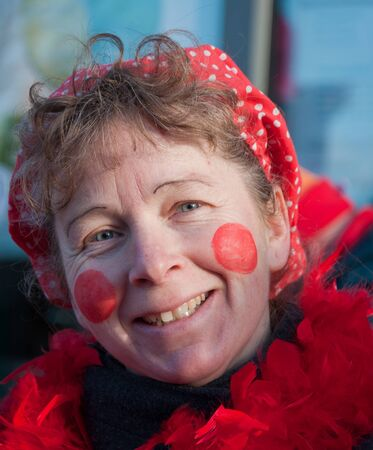 drimmelen: Made, North-Brabant, Netherlands – March 6, 2011 - Dutch carnival on the streets of a small village, costumed woman with scarf