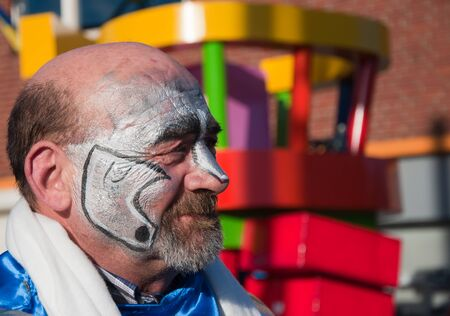 drimmelen: Made, North-Brabant, Netherlands – March 6, 2011 - Dutch carnival on the streets of a small village, costumed man Editorial