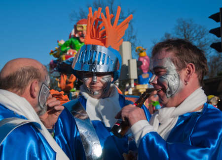 drimmelen: Made, North-Brabant, Netherlands – March 6, 2011 - Dutch carnival on the streets of a small village, costumed people Editorial