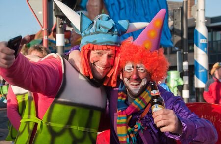 drimmelen: Made, North-Brabant, Netherlands – March 6, 2011 - Dutch carnival on the streets of a small village, costumed couple Editorial