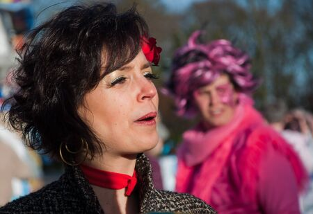 drimmelen: Made, North-Brabant, Netherlands – March 6, 2011 - Dutch carnival on the streets of a small village, beautiful woman with blach hair Editorial
