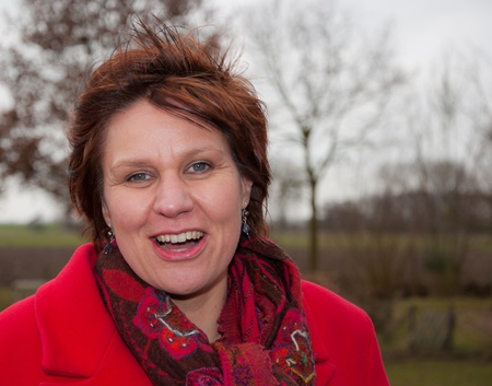 drimmelen: Drimmelen, North-Brabant, Netherlands – March 10, 2011 – Ruth Peetoom, Candidate Chairman CDA (Christian Democratic party Netherlands)  on introductory visit in the country, Ruth outside in the wind