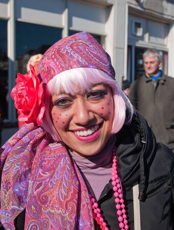 breda: Breda, North-Brabant, Netherlands – March 7, 2011 – Carnival Parade,  impression of the people, woman in pink