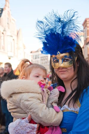 breda: Breda, North-Brabant, Netherlands – March 7, 2011 – Carnival Parade,  impression of the people, costumed mother with child