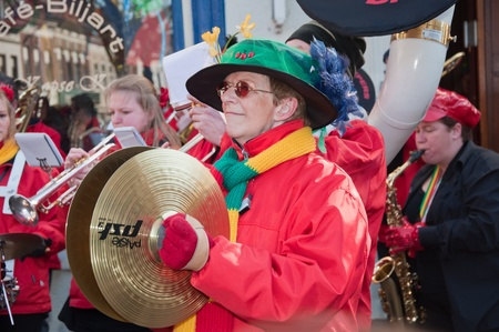 breda: Breda, North-Brabant, Netherlands – March 7, 2011 – Carnival Parade,  impression of the people, woman with green hat plays the cymbals Editorial
