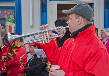 Breda, North-Brabant, Netherlands – March 7, 2011 – Carnival Parade,  impression of the people, male musician with a trumpet and a glass of beer Stock Photo - 9012636