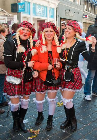 Breda, North-Brabant, Netherlands – March 7, 2011 – Carnival Parade,  impression of the people, three girlfriends Stock Photo - 9012745