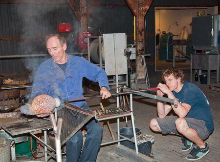 glassblower: Leerdam, Netherlands -  December 10, 2010: Master glass blower is creating a vase