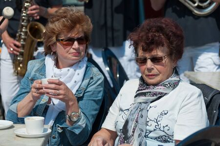 made in netherlands: Made, North-Brabant, Netherlands, April 30, 2011,  Two ladies on a terrace at Queensday