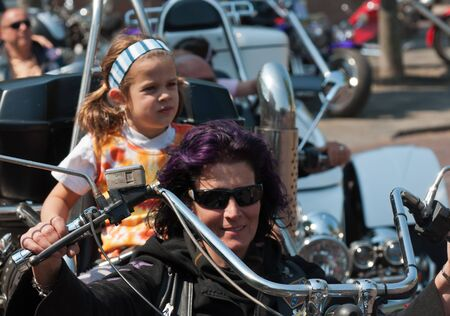 made in netherlands: Made, North-Brabant, Netherlands, April 30, 2011,  Portrait of a trike driver and her passenger at Queensday