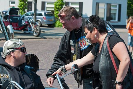 made in netherlands: Made, North-Brabant, Netherlands, April 30, 2011,  Portrait of trike drivers at Queensday Editorial