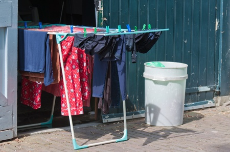drimmelen: Drimmelen, North-Brabant, Netherlands, May 5, 2011,  Colorful laundry attached at a standing rack with clothespins Editorial