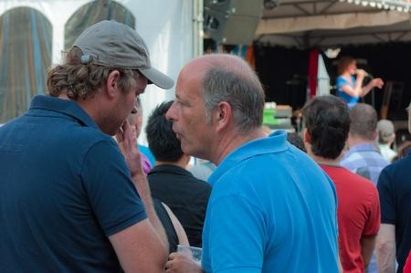 Breda, North-Brabant, Netherlands, June 4, 2011, Jazzfestval 2011,  Two gossiping men