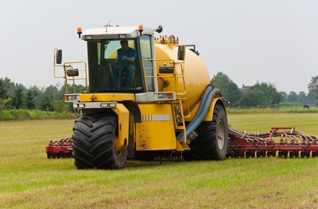 Manure injection in action in the field Stock Photo