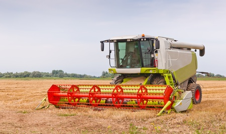 Close up of a combine after work at a Dutch field photo
