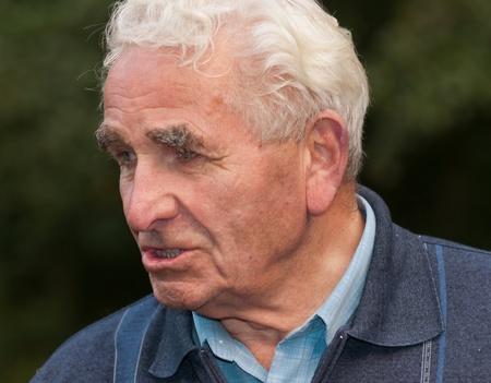 drimmelen: Drimmelen, North-Brabant, Netherlands, August 27, 2011, Impressive portrait of an old Dutch farmer