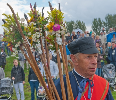 st mark: Guild Festival to mark the 460 anniversary of the Archers Guild of St. Antonius Abt from the Dutch village of Terheijden (North-Brabant) on Sunday, August 28, 2011. Portrait of a member of the Sebastiaan Guild from Essen (Belgium) with sticks decorated wi