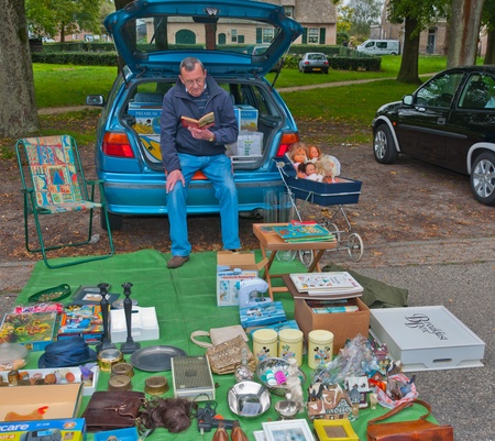 Car boot sale in the small Dutch village of Den Hout, North Brabant. Car boot sale in a village in the Netherlands on September 17, 2011 Stock Photo - 10592097