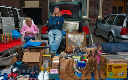 Car boot sale in the small Dutch village of Den Hout, North Brabant. Car boot sale in a village in the Netherlands on September 17, 2011 Stock Photo - 10592096