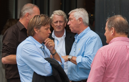 Managers are discussing seriously in front of the building during the break of a meeting in the city of Breda, North-Brabant, Netherlands on September 4, 2011.